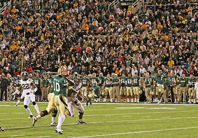 This is a 12 shot sequence picture of Heisman Trophy Winner, RG III, Robert Griffin III passing to Kendall Wright #1 at the Baylor-Missouri game. You can see the track the ball follows as it travels from the quarterback to the receiver and the final catch. My camera fires 10 bursts per second so you can see the length of time the ball was in the air. Click on the picture for a larger view.