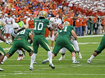 Heisman Trophy Winner Robert Griffin III taking a snap from the center against Texas.