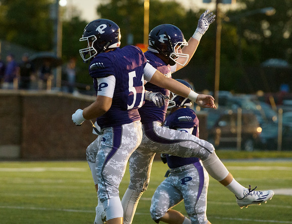 Globe/Roger Nomer<br /> Pittsburg's Drew White (51) and Tye Cicero celebrate a fumble recovery during Friday's home game against Webb City.