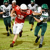 Globe | Steve Wood<br /> Mt. Vernon's Chance Fenton fights through a stiff arm by Seneca's Matt Hymer to make the tackle.