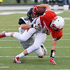 Globe/Roger Nomer<br /> Webb City's Alex Gaskill tries to stay on his feet while being tackled by Willard's Jody Hall during Friday's game in Webb City.