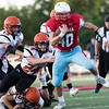 Globe|Israel Perez<br /> Webb City's Cameron Baker (40) gets away from three of Republic's defensive lineman Jaden Duvall (13), Case Birlew (24) and Maverick Lopez (25) during their game on Friday night at Cardinal Stadium in Webb City.