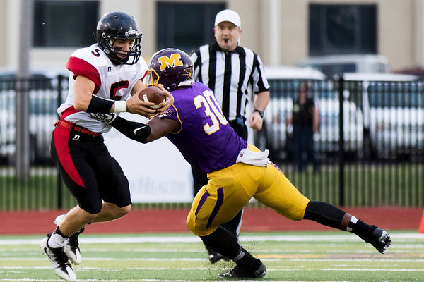 Globe|Israel Perez<br /> Lamar's Matt Whyman (5) gets away from Monett's Michael Branch (30) during their game on Friday night against at the Burl Fowler Stadium in Monett.