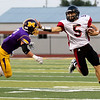 Globe|Israel Perez<br /> Lamar's Matt Whyman (5) pushes off Lamar's Dale Slater (2) and gets past him during their game on Friday night against at the Burl Fowler Stadium in Monett.