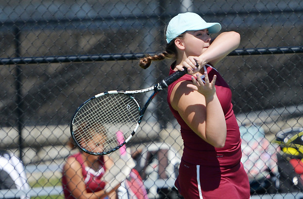 Globe/Roger Nomer<br /> Joplin's Meredith Bond follows through on a shot during a home match against Neosho on Monday.