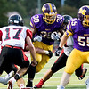 Globe|Israel Perez<br /> Monett's Michael Branch (30) goes through the middle of Lamar's defensive line during their game on Friday night against at the Burl Fowler Stadium in Monett.