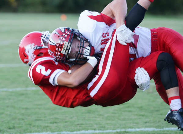 Globe/Roger Nomer<br /> Oswego's Devin Wilkerson tackles Baxter Springs' Donovan Anderson during Friday's game in Baxter Springs.