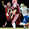 Globe|Israel Perez<br /> Baxter Springs' quarterback Trey White (3) throws a pass under pressure to Doug Darnenne (34) during their game on Friday night against Riverton at Baxter Springs High School.