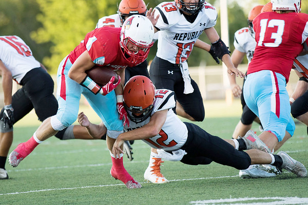 Globe|Israel Perez<br /> Webb City's Hunter Vanlue (28) gets away from Republic's Devon Ward (12) during their game on Friday night at Cardinal Stadium in Webb City.