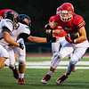 Globe|Israel Perez<br /> Carl Junction's Dayton McIntouch (2) finds a gap on Branson's defensive line during their game on Friday night at Bulldog Stadium in Carl Junction .