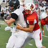 Globe/Roger Nomer<br /> Webb City's Trey Gibson tackles Willard's Nate Swadley during Friday's game in Webb City.