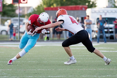 Globe|Israel Perez Webb City's Alex Gaskill (6) prepares for a tackle from Republic's Cooper Powell (43) during their game on Friday night at Cardinal Stadium in Webb City Mo.
