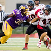 Globe|Israel Perez<br /> Monett's Michael Branch (30) tackles Lamar's Anthony Wilkerson (43) during their game on Friday night against at the Burl Fowler Stadium in Monett.