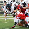 Globe/Roger Nomer<br /> Webb City's Jordon Rogers, top, and Will Larson combine on a tackle of Willard's Brock Howard during Friday's game in Webb City.
