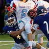 Globe/Roger Nomer<br /> Pittsburg's Joe Tallie wraps up Webb City's Alex Gaskill during Friday's game in Pittsburg.