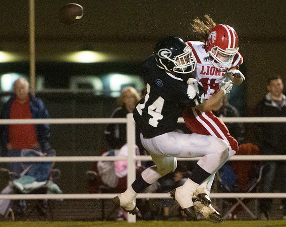 Globe/Roger Nomer<br /> Galena's Garrett Hall and Baxter Springs' Tyler Price collide while going up for a pass during Friday's game in Galena.