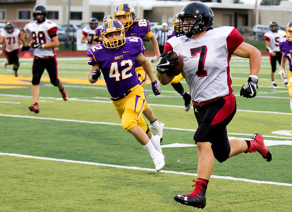 Globe|Israel Perez<br /> Lamar's Cooper Lucas (7) gets past Monett's Aaron Howard (42) for a touchdown during their game on Friday night against at the Burl Fowler Stadium in Monett.