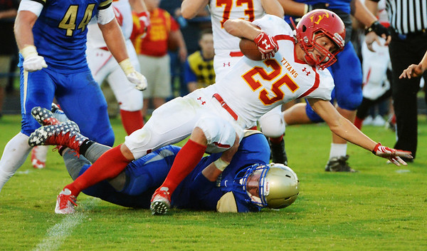 Globe/Roger Nomer<br /> Riverton's Matt Duley tackles Columbus' Peyton Hale during Friday's game in Riverton.
