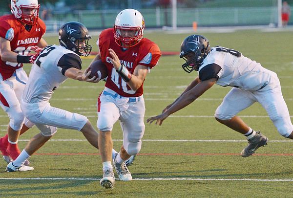 Globe/Roger Nomer<br /> Webb City's Cameron Baker runs between Willard's Dakota Mainprize (32) and Sydney Mavengere (82) to score a touchdown during Friday's game in Webb City.