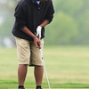 Globe/Roger Nomer<br /> McAuley's Andrew Castillo putts on Monday at Schifferdecker Golf Course.