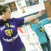 Globe/Roger Nomer<br /> Archery coach Kaycia Woolsey instructs Lyazia Parker, 10, on her form during practice at Sarcoxie.