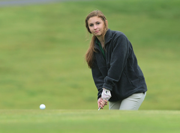 Globe/Roger Nomer<br /> College Heights' Ashley Roberts watches as her shot approaches the green on Monday at Schifferdecker Golf Course.