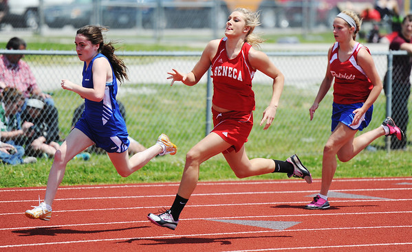 Globe/T. Rob Brown<br /> Seneca's Shelby Perry (center) competes in the 200-meter during Carl Junction's track event Saturday, May 11, 2013. Perry ended up winning the heat.
