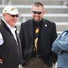 Globe/T. Rob Brown<br /> Track coach Tom Rutledge shares a laugh at Fred G. Hughes Stadium.