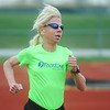 Globe/Roger Nomer<br /> Karen Plucinski trains for the Boston Marathon at the Carl Junction High School track on Saturday, April 6, 2013.
