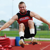 Globe/T. Rob Brown<br /> Carl Junction junior Chris Whelan competes in the long jump during Carl Junction's track event Saturday, May 11, 2013.