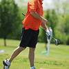 Globe/T. Rob Brown<br /> Doug Harvey winner of the senior division of the city golf tournament watches his ball fly after teeing off Saturday afternoon, May 11, 2013, at Schifferdecker.