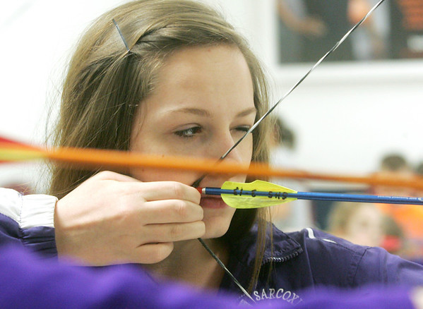 Globe/Roger Nomer<br /> America Berry, Sarcoxie sophomore, takes aim during archery practice at the school.  Berry took first in the state competition.