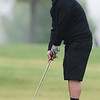 Globe/Roger Nomer<br /> McAuley's Chase Damer sinks a putt on Monday at Schifferdecker Golf Course.