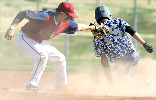 Neosho's Alec Gorham safely steals second base as Joplin's Chris Leonardi applies the tag during their game on Friday at Wendell Redden Field.<br /> Globe | Laurie Sisk