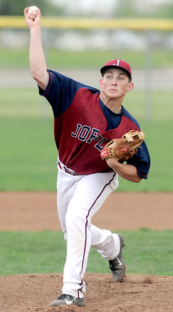 Joplin pitcher Tristan Ash hurls a pitch toward the plate during the Eagles' game against Willard on Monday at Wendell Redden Field.<br /> Globe | Laurie Sisk
