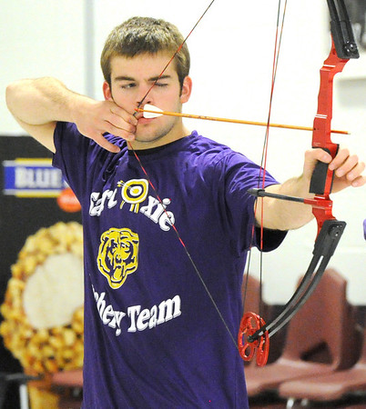 Sarcoxie archer Brice Dobbs draws his bow during archery practice on Wednesday at Sarcoxie High School.<br /> Globe | Laurie Sisk