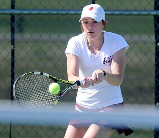 Carl Junction graduate Emily Cook warms up before her first match on Friday at the Joplin Athletic Complex. Cook now plays for Evangel.<br /> Globe | Laurie Sisk