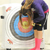 Sarcoxie archer Alyssa Lambeth retreives her arrows from the target during archery practice on Wednesday at Sarcoxie High School.<br /> Globe | Laurie Sisk