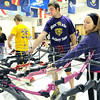 Sarcoxie archers Brice Dobbs and Alyssa Lambeth draw their bows from the rack during archery practice on Wednesday at Sarcoxie High School.<br /> Globe | Laurie Sisk