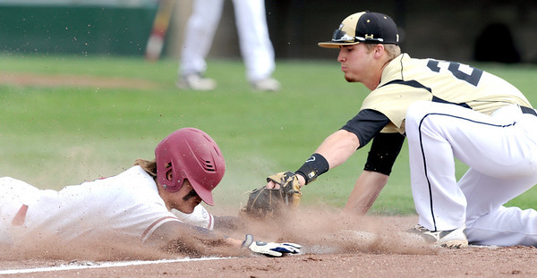 Joplin's Chris Leonardi slides safely under the tag of Lebanon third baseman Dylan Bradshaw during their game on Wednesday at Joe Becker Stadium.<br /> Globe | Laurie Sisk