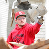 Baxter Springs High School third baseman Derek Barnes assists with cleanup near Ninth and Cherokee streets in Baxter Springs on Tuesday. <br /> Globe | Laurie Sisk