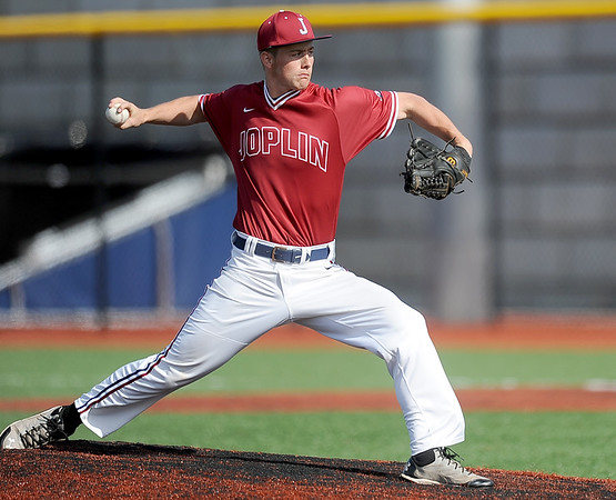Joplin pitcher Tyler McGrew hurls a pitch toward the plate during the Eagles' game against Lebanon on Thursday at JHS.<br /> Globe | Laurie Sisk