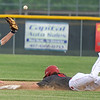 Mount Vernon's Chance Fenton can't hang on to the catcher's throw as Carl Junction's Ryan Devore steals second base during their game on Tuesday at CJHS.<br /> Globe | Laurie Sisk