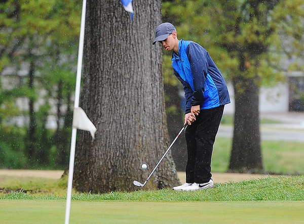 Globe/Roger Nomer<br /> Ty Gary, Carthage junior, hits onto the green during Monday's tournament in Carthage.