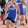 Commerce runner Chandler Wilson (front) takes the baton from teammate Chris Ibarra enroute to a win in the boys' 4x200 relay on Saturday at Sarcoxie High School.<br /> Globe | Laurie Sisk