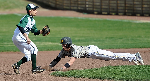 Diamond's Blake Drake slides comfortably into second base as Quapaw's Cody Gaines mans the bag during the 17th Annual Mickey Mantle Classic on Thursday at Joe Becker Stadium.<br /> Globe | Laurie Sisk