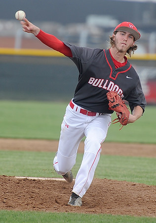 Carl Junction's Ethan Frack delivers from the mound during the Bulldog's game against Mount Vernon on Tuesday at CJHS.<br /> Globe   Laurie Sisk