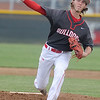 Carl Junction's Ethan Frack delivers from the mound during the Bulldog's game against Mount Vernon on Tuesday at CJHS.<br /> Globe | Laurie Sisk