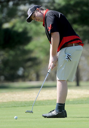 Lamar golfer Nathan McArthur hits a putt on the no. 16 green during the Joplin Invitational on Thursday at Twin Hills.<br /> Globe | Laurie Sisk