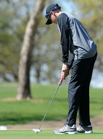 Willard golfer Jacob Shackelford hits a putt on the no. 16 green during the Joplin Invitational on Thursday at Twin Hills.<br /> Globe | Laurie Sisk